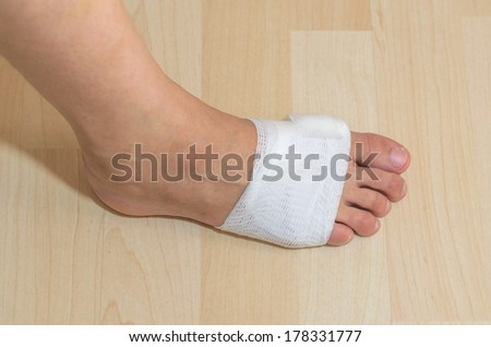 White medicine bandage on injury foot