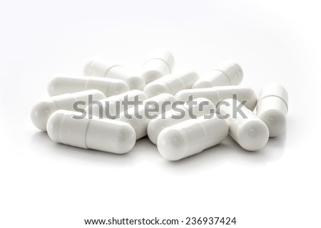White medicine capsules - stock photo