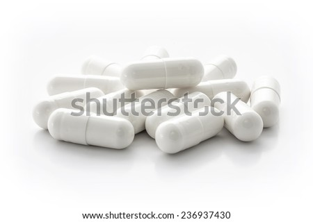 White medicine capsules - stock photo