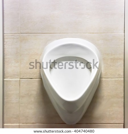 White men urinal in the public toilet - stock photo