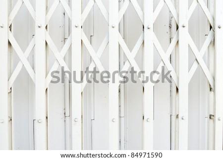White metal balustrade  of the telephone shop. - stock photo
