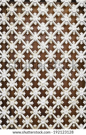 White metal fence, detail of a grille protection with decoration, security - stock photo
