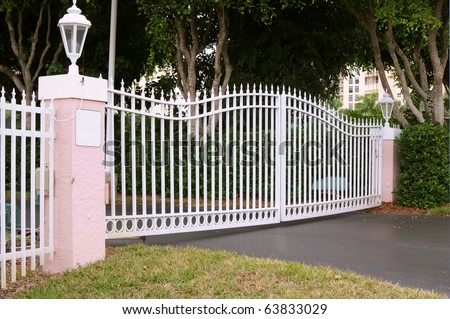 White metal gate with pink pillars