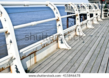 White metal railings at the edge of a pier