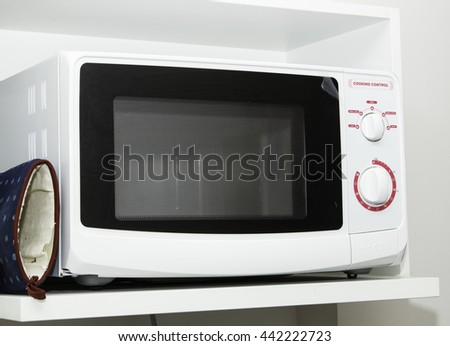 White microwave for cooking in kitchen