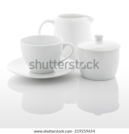 White milk jug, sugar bowl and coffee cup isolated on white background. with PS paths - stock photo