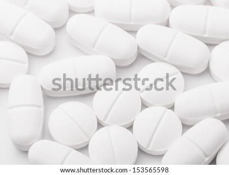 White mixing pills - stock photo