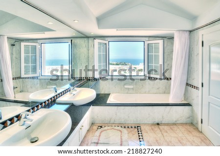 white modern bathroom with sea view - stock photo