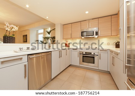White modern contemporary kitchen in townhouse - stock photo