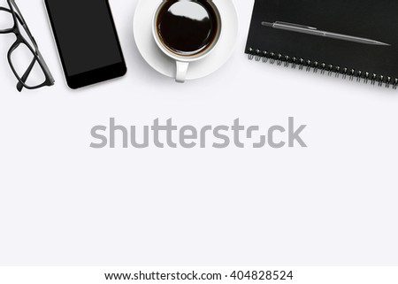 White modern desk with supplies. Top view with copy space. - stock photo