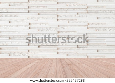 White modern marble tile wall with wooden floor in natural red brown color : Granite tiled wall pattern texture background in natural  light white cream color tone with red wood floor - stock photo