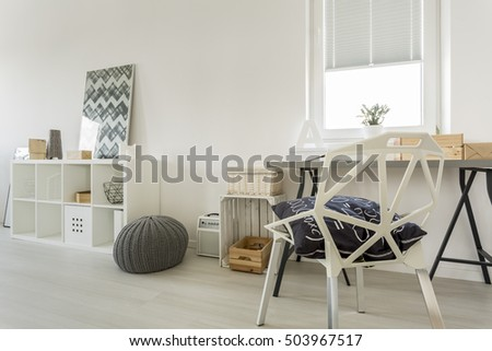 White modern room with window, desk, crystal chair and cabinet