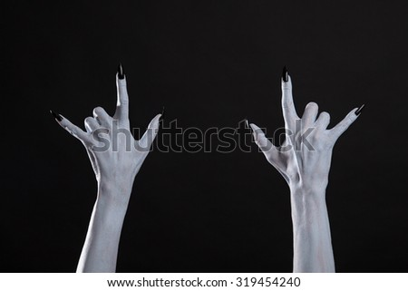 White monster hands showing heavy metal sign, Halloween or music theme  - stock photo