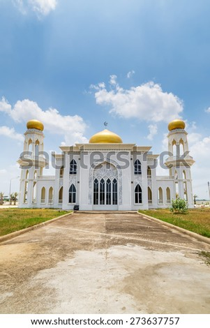 white mosque with a blue sky