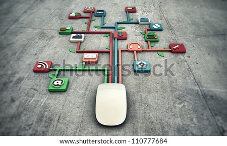 white mouse on concrete floor with media icons connected together - stock photo