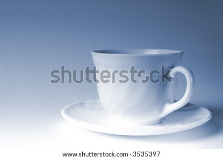 white mug of coffee on a white background, with the admixture of blue tones - stock photo