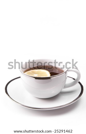 White mug with lemon on white background.