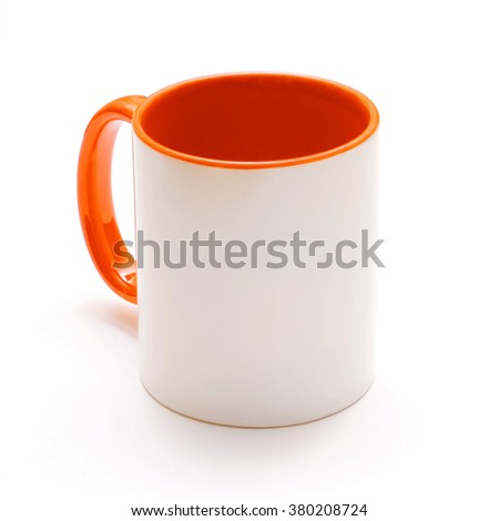 White mug with orange handle