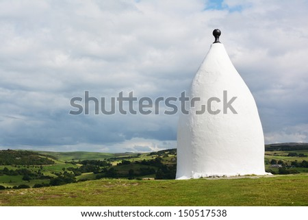 White Nancy folly in Bollington near Macclesfield, Cheshire, England. View of the Peak District hills in the background - stock photo