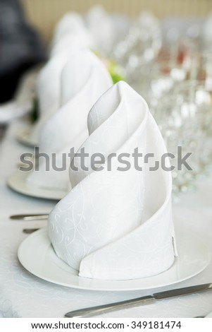 White napkin in restaurant. Table - stock photo