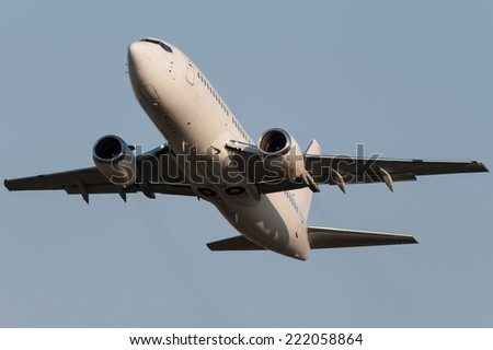 White narrow body Boeing climbing into the sky - stock photo