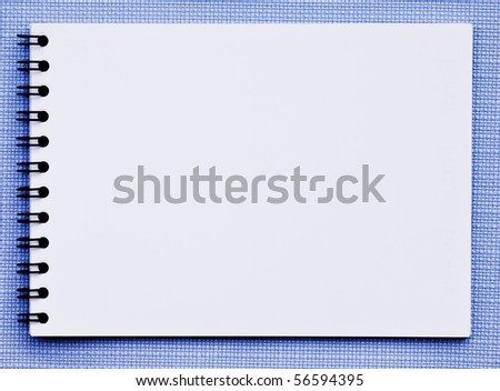 white note pad on a blue background. - stock photo