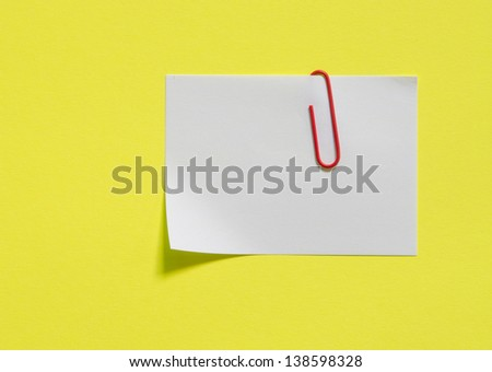white note paper with paperclip - stock photo