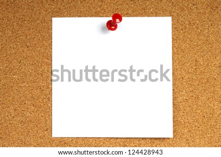 White note with pin on wooden background