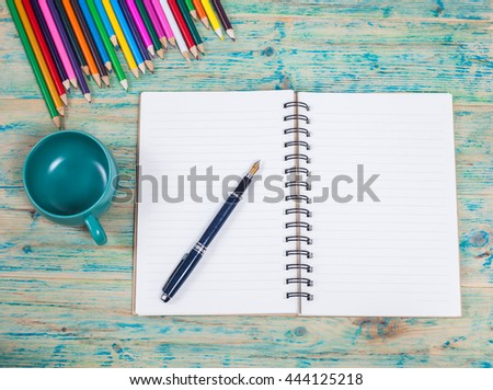 white notebook ,pen and office supplies on 