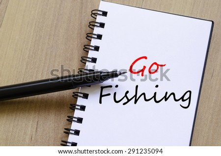 White notepad and ink pen on the wooden desk  and text concept - stock photo