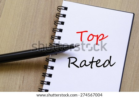 White notepad and ink pen on the wooden desk Top Rated Concept - stock photo