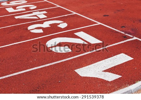 White numbers on red running track. Perspective view. Success and competition concept - stock photo