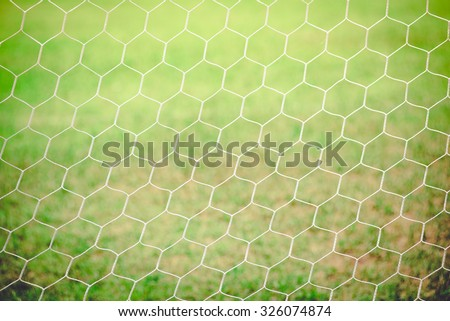 White nylon nets on green grass , vintage