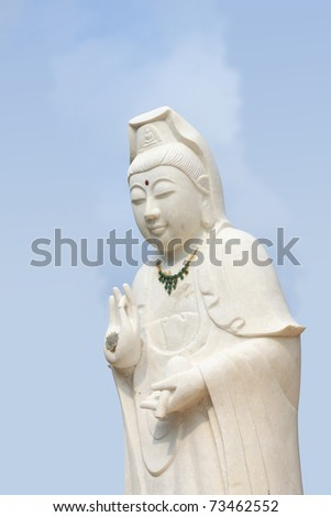 White of goddess of mercy (Kuan Yim) statue on coral island (Koh Larn).
