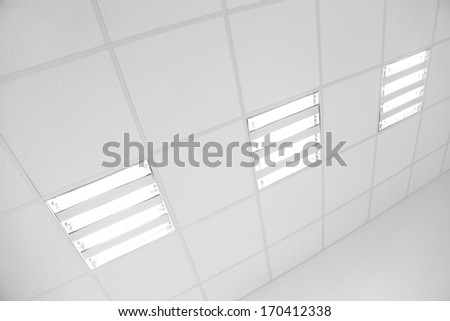 white office ceiling and modern light fluorescent lamps - stock photo