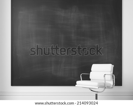 White office chair and blank chalkboard on a wall - stock photo