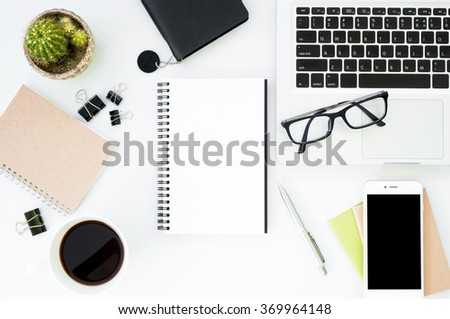White office desk table with a lot of things on it. Top view. - stock photo