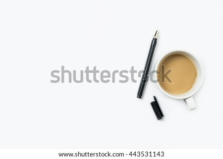White office desk table with coffee and pen. Top view with copy space, flat lay.