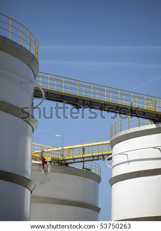 white oil tanks in the harbour of rotterdam - stock photo
