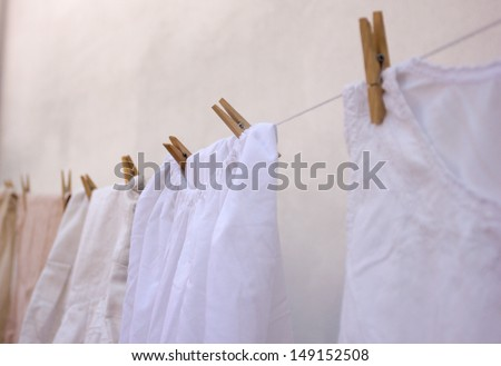 White old-fashioned laundry on the clothesline - stock photo