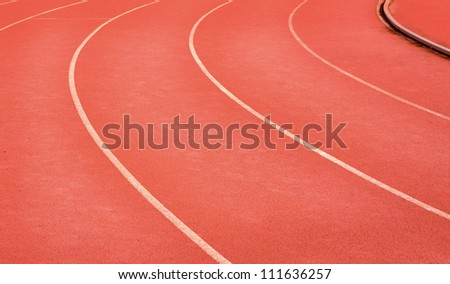 white on red running track curve in stadium