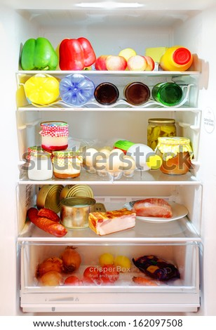 White Open Fridge with a many products  - stock photo