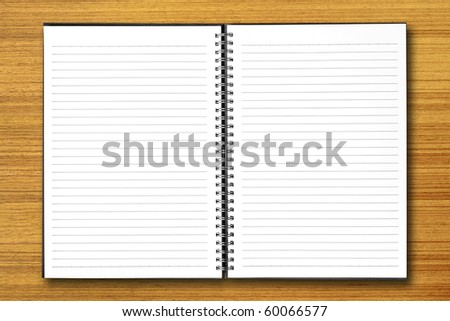 White open notebook on  wood background.