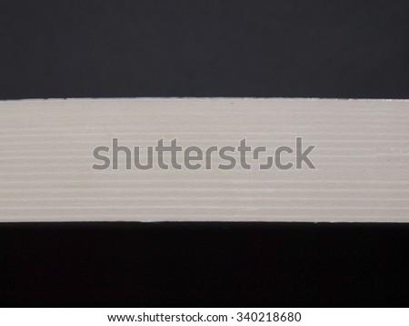 White or grey ribbon isolated over black background - stock photo