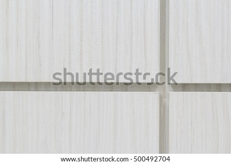 White or milky wooden particleboard glued to the wall