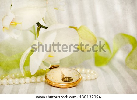 White orchid,pearls and golden swatch