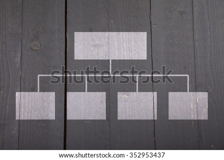 White organigram on black wooden background