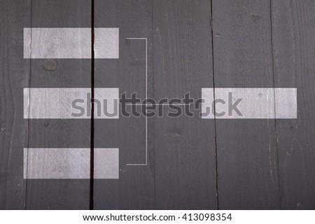White organigram on dark wooden background - stock photo