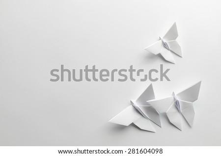White origami butterflies on white background - stock photo