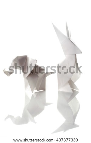 White origami elephant and rabbit isolated on white background with beautiful reflection.